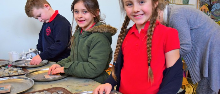 2 l-r Spencer Easton, Imogen Mason and Peyton Norville from Year 3 making mosaics